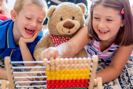 Photo for Little children playing with abacus at home. Concept of learning to count - Royalty Free Image