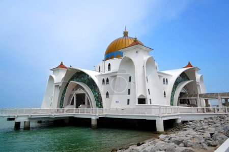Scenic view of Malacca Straits Mosque ( Masjid Selat Melaka) with blue sky