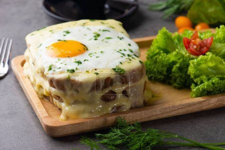 croque-madame toast with egg and cheese, selective focus