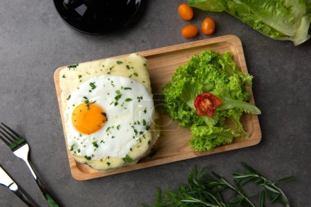 Croque madame toast with egg, chees and cherry tomatoes.