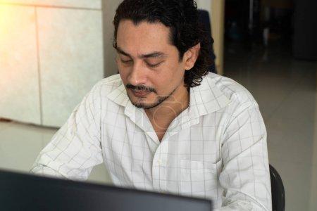 business pakistani man working at offic