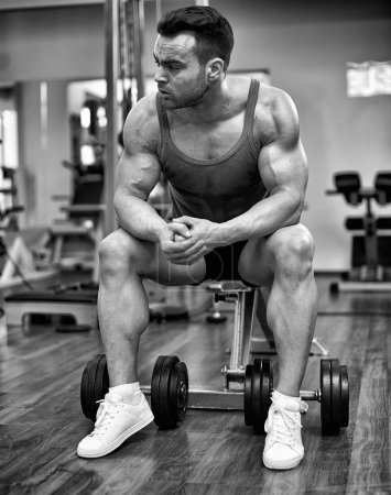 Photo for Athlete resting and concentrating before executing a workout in the gym - Royalty Free Image