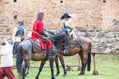 """CZERSK, POLAND - 23 JUNE, 2018: Historical picnic """"Swedes in the castle"""". Horse show performed, musketeer demonstrations are the main attractions of historical reconstruction at the castle in Czersk"""