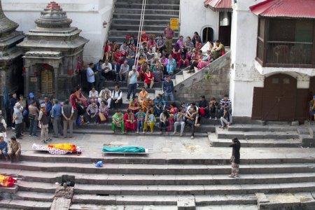 KATHMANDU, NEPAL - JULY 12, 2018: Temple crematorium Pashupatinath. People believe that cremation will give a spiritual rebirth.