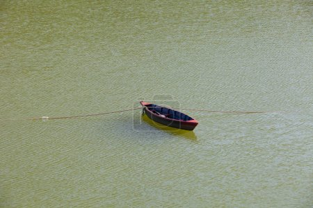 Small wooden boat on the Phewa Lake in Pokhara, Nepal