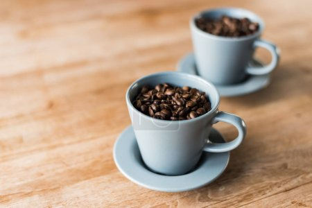 Photo for Cup of coffee beans on the wooden table - Royalty Free Image