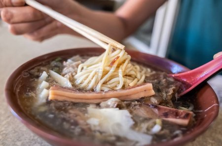 Taiwanese thickened soup noodle with lamb and squi...