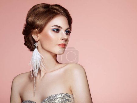 Photo for Beautiful Woman with Large Earrings Tassels Jewelry White Color. Perfect Makeup and Elegant Hairstyle. Blue Make-up Arrows - Royalty Free Image