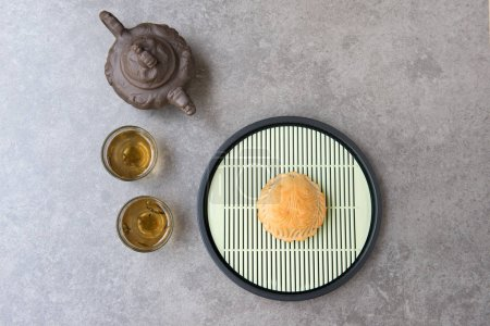 """Photo for Traditional mooncakes is offered to friends or family during Mid-Autumn Festival. Flatlay on table top down view grey background with copy space. The Chinese character on the moon cake represent """"lotus paste"""" in English. - Royalty Free Image"""