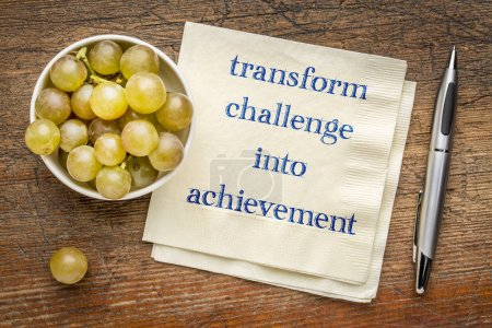 Photo for Transform challenge into achievement - inspirational handwriting on a napkin - Royalty Free Image