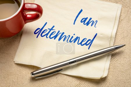 Photo for I am determined positive affirmation - handwriting on a napkin with a cup of coffe - Royalty Free Image
