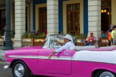 Havana, Cuba - 02 16 2018: Vintage classic American cars in restored condition - provide transport for tourism