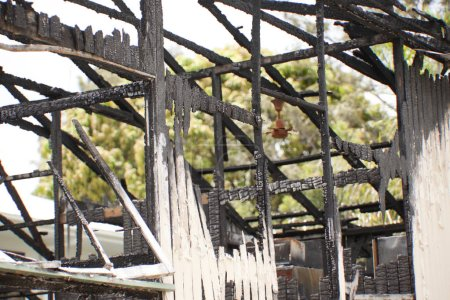 Burnt remains of a property after an house fire