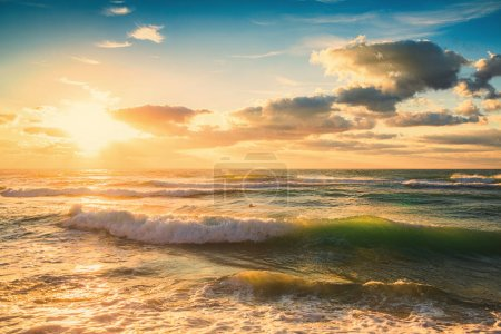 Photo for Summer morning. Sunrise over the beach. Waves splashing seascape - Royalty Free Image