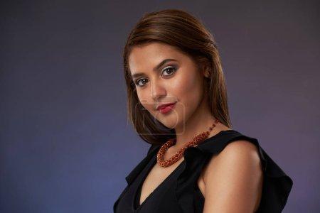 Pretty young latina woman close-up portrait...
