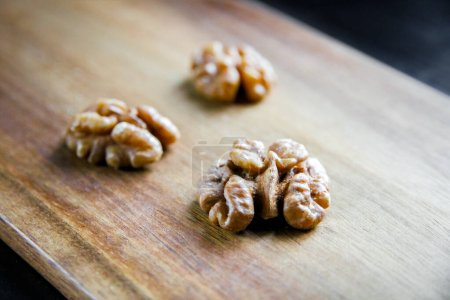 Photo for Walnut kernels on a wooden cutting board - Royalty Free Image
