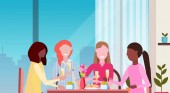 women drinking champagne enjoying food international happy 8 march day holiday concept mix race girls sitting at cafe table restaurant interior horizontal closeup portrait
