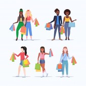 set people holding colorful paper bags mix race men women with purchases big sale shopping concept collection flat full length