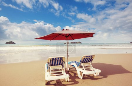 Photo for Beautiful ocean beach umbrella and loungers - Royalty Free Image