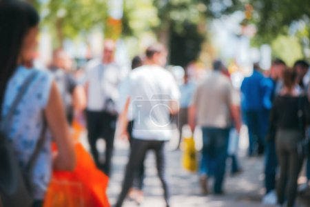 Photo for Abstract blurry background, people walking on crowded street on sunny summer day. Defocus blurred background as graphic design element. - Royalty Free Image