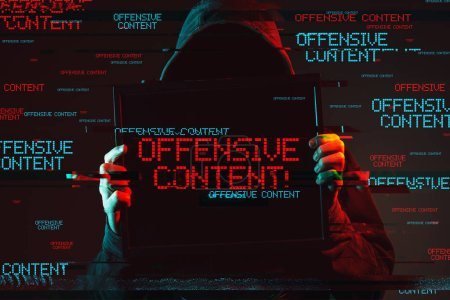 Photo for Offensive content concept with faceless hooded male person holding computer monitor, low key red and blue lit image and digital glitch effect - Royalty Free Image