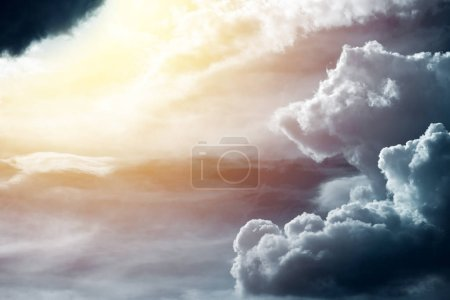 Beautful warm divine light behind the stormy cloud in the sky as new hope rising metaphor