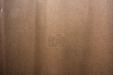 Photo for Corrugated cardboard paper material texture background, rough and weathered grungy backdrop - Royalty Free Image
