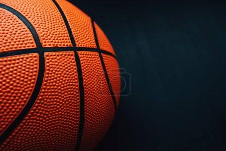 Photo pour Basketball sur fond sombre, espace de copie inclus - image libre de droit