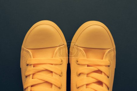 Photo for Stylish yellow sneakers from above, young person unisex style and fashion concept with copy space, top view - Royalty Free Image