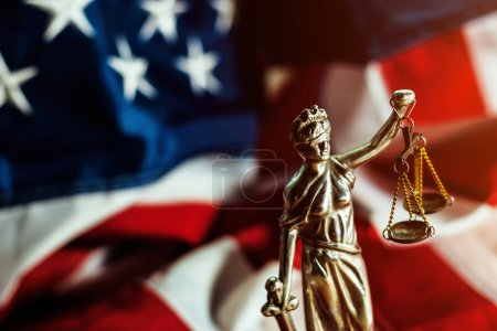 Photo for Law and Justice in United States of America, statue of Lady Justice with USA flag in background, selective focus - Royalty Free Image