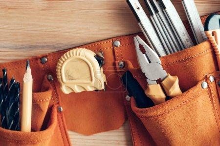 Photo for Female carpenter organizing tool belt set in woodwork workshop, close u - Royalty Free Image