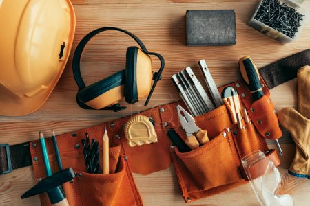 Photo for Professional handyman tool belt on the desk in workshop - Royalty Free Image