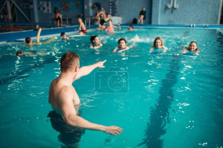 Photo for Aqua aerobics workout with equipment in water sport center, indoor swimming pool, recreational leisure - Royalty Free Image