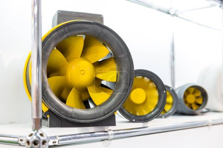 Air fans, exhibition sample in the store. Ventilation system engine on the shelf in the shop