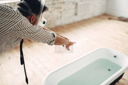 Funny businessman in mask dives into the bathtub, humor. Business fortune concept