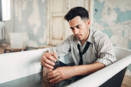 Photo for Drunk businessman in bathtub, suicide man concept. Problem in business, stress - Royalty Free Image