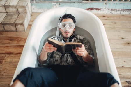Funny businessman in mask lies in bathtub and reads book, humor. Business lottery concept