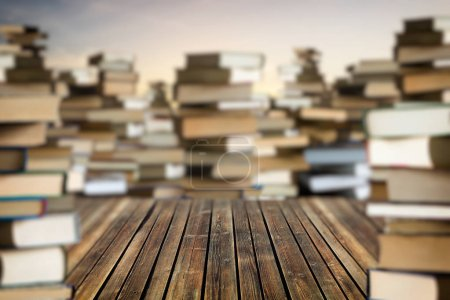 Photo for Space among stacks of books. Lots of books around. Gaining knowledge and education concept - Royalty Free Image
