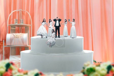 Wedding cake, groom and many brides figurines on the top. Dummy pie for newlyweds with little figures