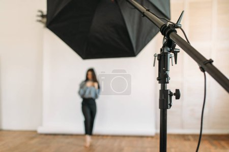 Photo for Beautiful model poses in photo studio, white background, lighting equipment. Attractive woman on photo studio shot - Royalty Free Image
