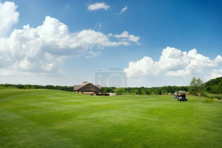 Trimmed field and sand bunkers for game on golf course, nobody. Green meadow in golfing club, playground in sunny day