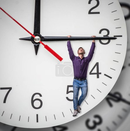 Man hangs on the arrow of a huge clock. Deadline concept, time does not stop