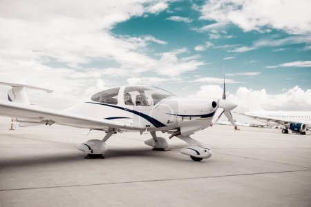 Propeller airplane in airport, plane on aircraft parking zone. Private airline, air transportation