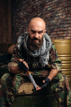 Terrorist in uniform with knife