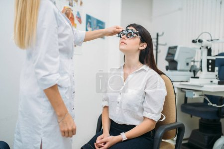 Photo for Diopter selection, diagnostics of vision, professional choice of glasses. Eyesight test in optician cabinet. Patient and ophthalmologist, eye care consultation - Royalty Free Image