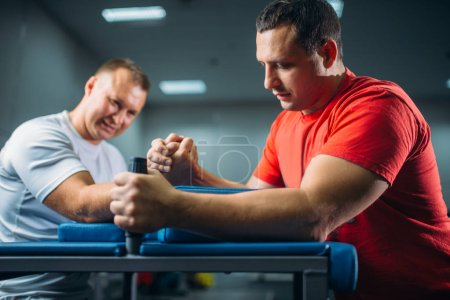 Two arm wrestlers fighting on