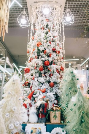 Photo for Christmas fir tree, festive decoration and gift boxes, nobody. Holiday celebration symbol, toys or bauble - Royalty Free Image