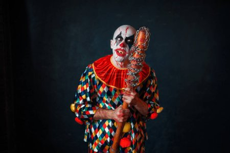 Photo for Mad bloody clown with baseball bat. Man with makeup in halloween costume, zombie - Royalty Free Image