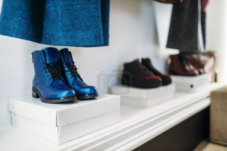 Photo for Showcase with stylish female shoes in clothing store, nobody. Boots collection in fashion boutique - Royalty Free Image