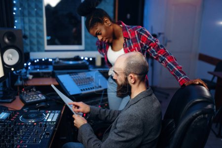 Photo for Bearded sound engineer at remote control panel in audio recording studio. Musician at the mixer, professional music mixing - Royalty Free Image